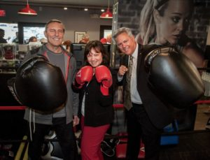 FIGHT IT OUT—Thousand Oaks City Councilmembers Al Adam and Claudia Bill-de la Peña along with Mayor Joel Price pose with a purpose at the Boxing Against Parkinson's Disease Program open house on Saturday at Title Boxing Club in Newbury Park.